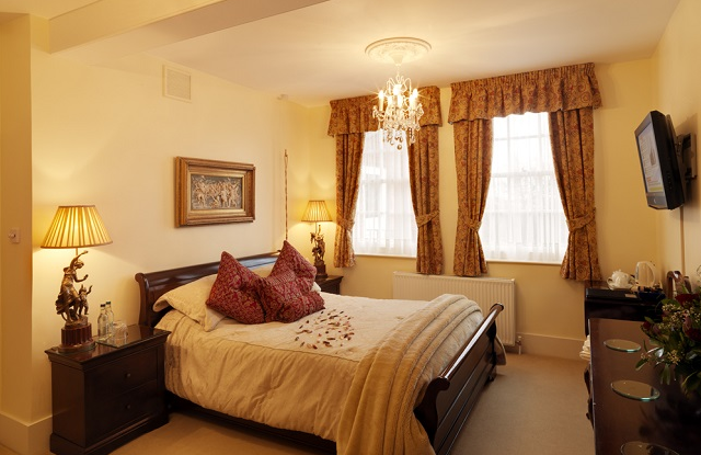 Royal Military Suite includes a great bathroom with corner shower and double ended bath